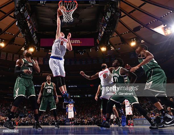 Kristaps Porzingis of the New York Knicks dunks the ball against the Milwaukee Bucks at Madison Square Garden on November 6 2015 in New YorkNew York...