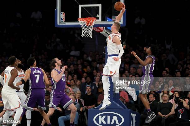 Kristaps Porzingis of the New York Knicks dunks the ball against the Sacramento Kings in the first half during their game at Madison Square Garden on...
