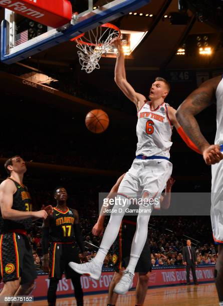 Kristaps Porzingis of the New York Knicks dunks the ball against the Atlanta Hawks at Madison Square Garden on December 10 2017 in New York New York...