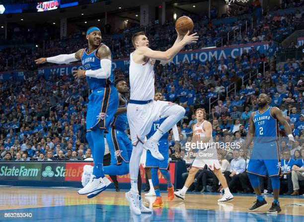 Kristaps Porzingis of the New York Knicks goes past Carmelo Anthony of the Oklahoma City Thunder for two points during the second half of a NBA game...