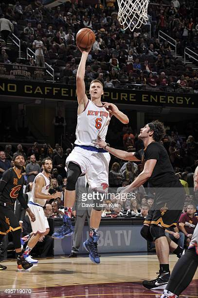 Kristaps Porzingis of the New York Knicks goes to the basket against the Cleveland Cavaliers on November 4 2015 at Quicken Loans Arena in Cleveland...