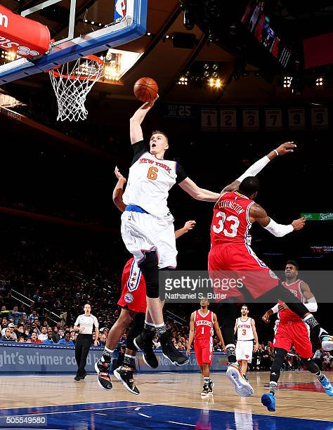 Kristaps Porzingis of the New York Knicks goes up for a dunk against the Philadelphia 76ers on January 18 2016 at Madison Square Garden in New York...