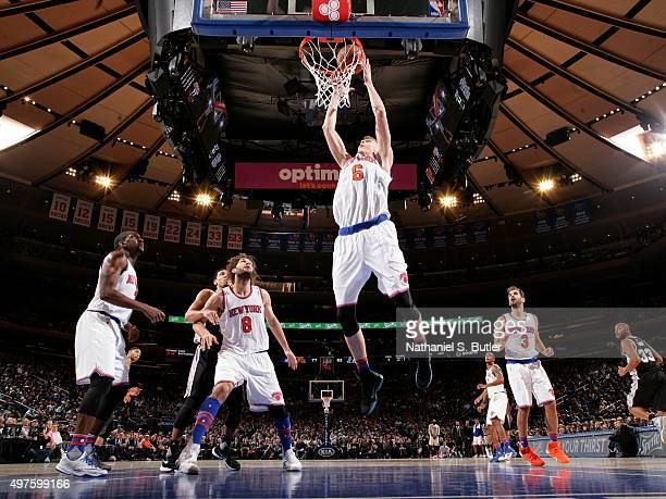 Kristaps Porzingis of the New York Knicks goes up for a rebound against the San Antonio Spurs during the game on November 2 2015 at Madison Square...