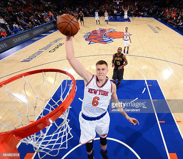 Kristaps Porzingis of the New York Knicks goes up for the dunk against the Atlanta Hawks at Madison Square Garden on October 29 2015 in New YorkNew...