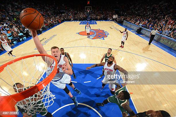 Kristaps Porzingis of the New York Knicks goes up for the dunk against the Milwaukee Bucks at Madison Square Garden on November 6 2015 in New YorkNew...