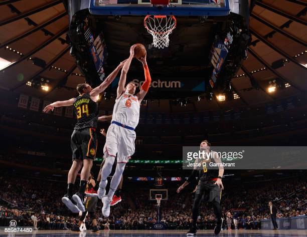 Kristaps Porzingis of the New York Knicks goes up with the ball against the Atlanta Hawks at Madison Square Garden on December 10 2017 in New York...
