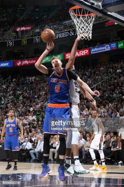 Kristaps Porzingis of the New York Knicks grabs the rebound against the Utah Jazz on March 22 2017 at vivintSmartHome Arena in Salt Lake City Utah...