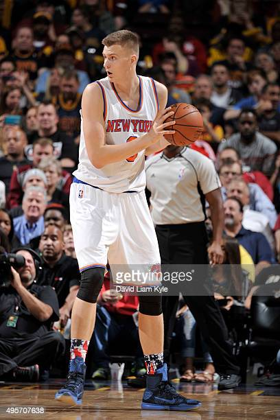 Kristaps Porzingis of the New York Knicks handles the ball against the Cleveland Cavaliers on November 4 2015 at Quicken Loans Arena in Cleveland...