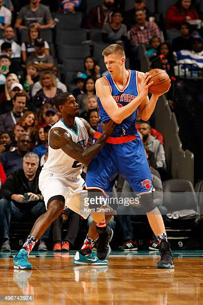 Kristaps Porzingis of the New York Knicks handles the ball against Marvin Williams of the Charlotte Hornets during the game at the Time Warner Cable...