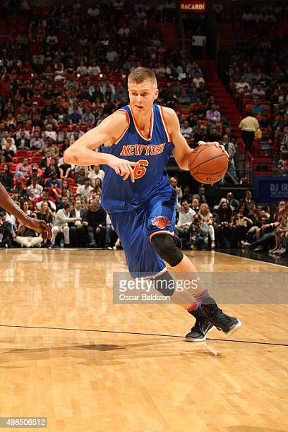 Kristaps Porzingis of the New York Knicks handles the ball against the Miami Heat on November 23 2015 at American Airlines Arena in Miami Florida...