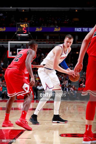 Kristaps Porzingis of the New York Knicks handles the ball against the Chicago Bulls on December 9 2017 at the United Center in Chicago Illinois NOTE...