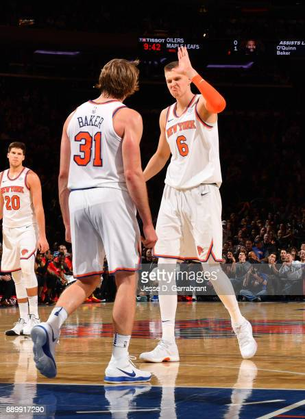 Kristaps Porzingis of the New York Knicks is pumped up with Ron Baker against the Atlanta Hawks at Madison Square Garden on December 10 2017 in New...