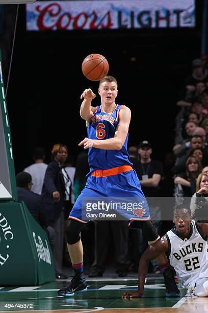 Kristaps Porzingis of the New York Knicks makes a pass against the Milwaukee Bucks on October 28 2015 at the BMO Harris Bradley Center in Milwaukee...
