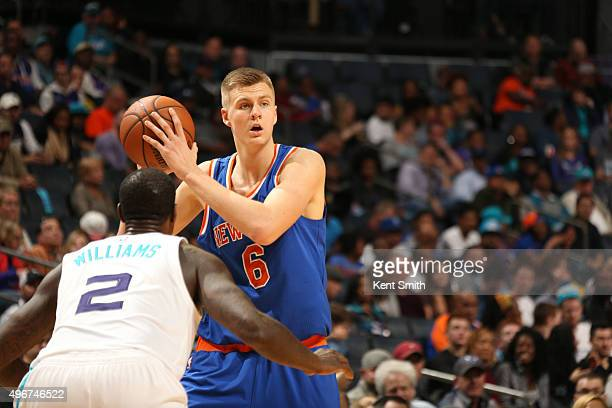 Kristaps Porzingis of the New York Knicks on the pass against Marvin Williams of the Charlotte Hornets during the game at the Time Warner Cable Arena...