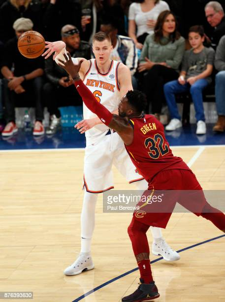Kristaps Porzingis of the New York Knicks passes in front of Jeff Green of the Cleveland Cavaliers in an NBA basketball game on November 13 2017 at...