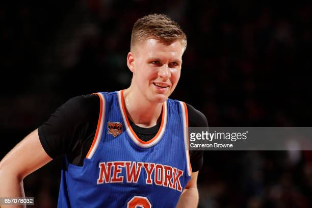 Kristaps Porzingis of the New York Knicks reacts to a play during the game against the Portland Trail Blazers on March 23 2017 at the Moda Center in...
