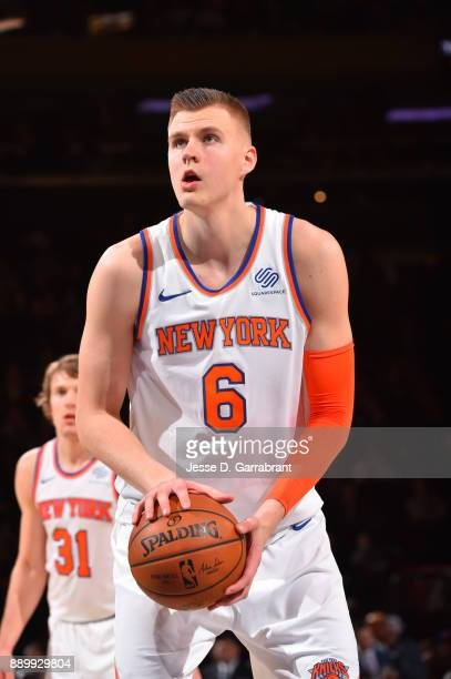 Kristaps Porzingis of the New York Knicks shoots a foul shot against the Atlanta Hawks at Madison Square Garden on December 10 2017 in New York New...