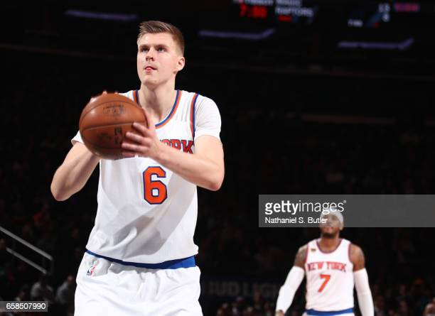 Kristaps Porzingis of the New York Knicks shoots a free throw during a game against the Detroit Pistons on March 27 2017 at Madison Square Garden in...