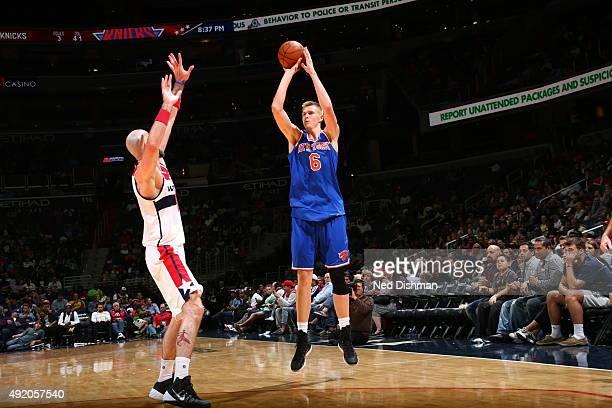 Kristaps Porzingis of the New York Knicks shoots against Marcin Gortat of the Washington Wizards during a preseason game on October 9 2015 at Verizon...