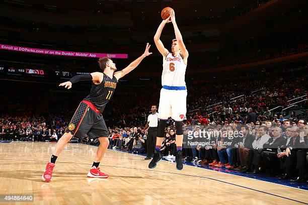 Kristaps Porzingis of the New York Knicks shoots against Tiago Splitter of the Atlanta Hawks on October 29 2015 at Madison Square Garden in New York...