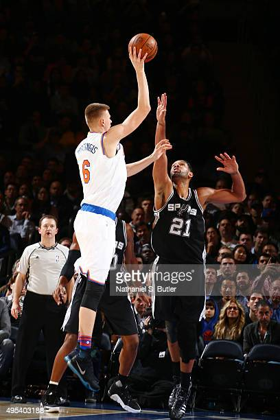 Kristaps Porzingis of the New York Knicks shoots against Tim Duncan of the San Antonio Spurs during the game on November 2 2015 at Madison Square...