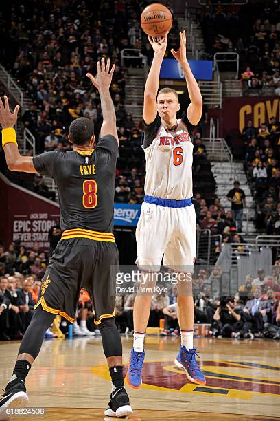 Kristaps Porzingis of the New York Knicks shoots the ball against the Cleveland Cavaliers on October 25 2016 at Quicken Loans Arena in Cleveland Ohio...