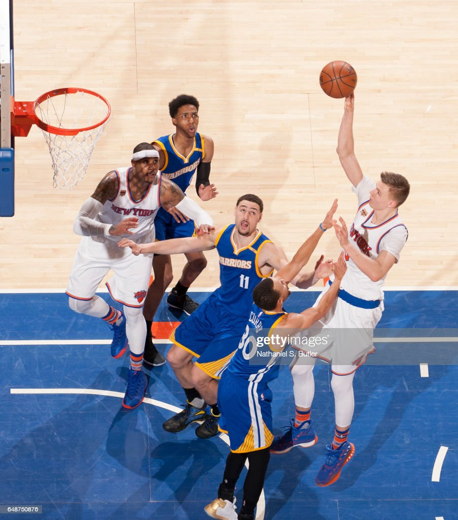 Kristaps Porzingis #6 of the New York Knicks shoots the ball against the Golden State Warriors on March 5, 2017 at Madison Square Garden in New York City, New York.