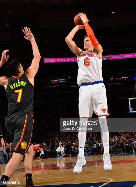 Kristaps Porzingis of the New York Knicks shoots the ball against the Atlanta Hawks at Madison Square Garden on December 10 2017 in New York New York...