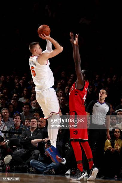 Kristaps Porzingis of the New York Knicks shoots the ball during the game against the Toronto Raptors on November 22 2017 at Madison Square Garden in...