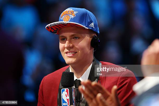 Kristaps Porzingis speaks to the media after being selected fourth overall by the New York Knicks in the First Round of the 2015 NBA Draft at the...