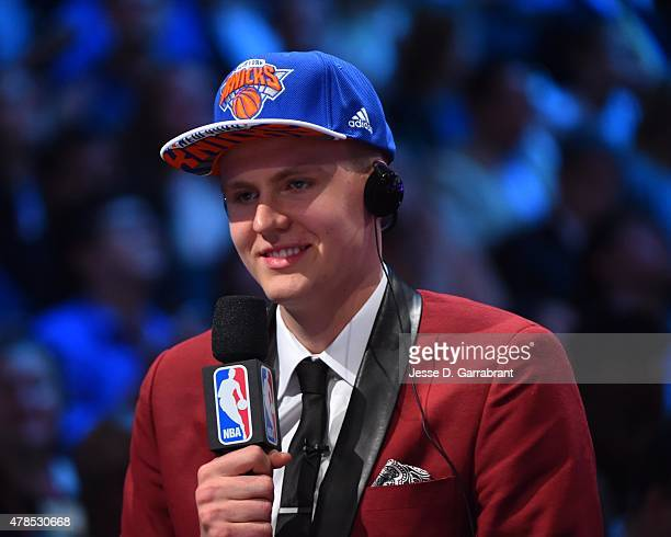 Kristaps Porzingis the 4th pick overall in the 2015 NBA Draft by the New York Knicks speaks to the media during the 2015 NBA Draft at the Barclays...
