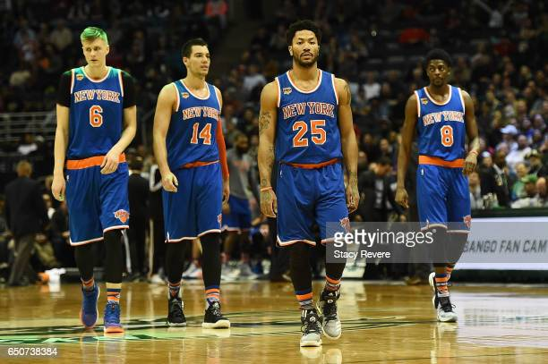 Kristaps Porzingis Willy Hernangomez Derrick Rose and Justin Holiday of the New York Knicks take the court during a game against the Milwaukee Bucks...