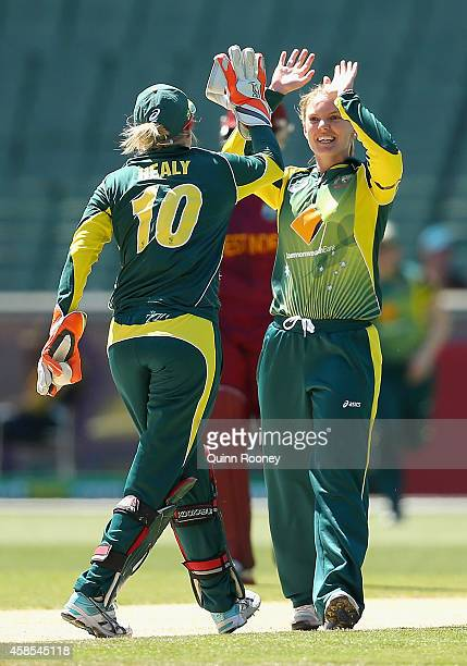 Kristen Beams of Australia is congratulated by Alyssa Healy after getting the wicket of Deandra Dottin of the West Indies during game three of the...