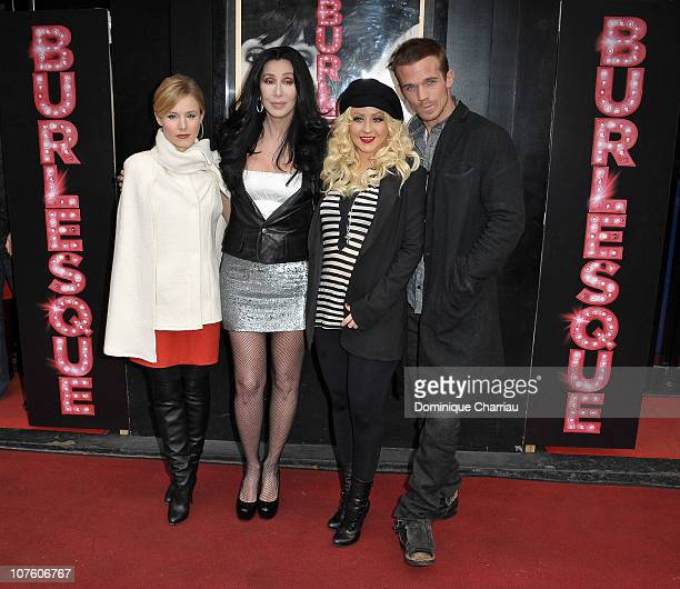 Kristen Bell Cher Christina Aguilera and Cam Gigandet attend the Burlesque Photocall at Le Crazy Horse on December 15 2010 in Paris France