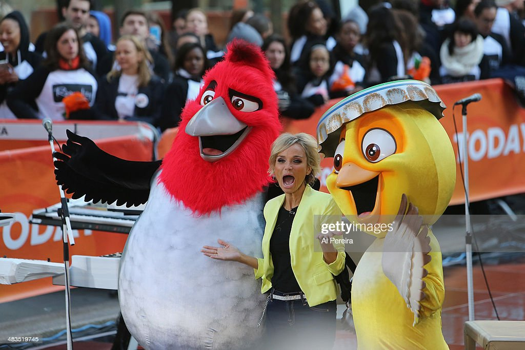 Kristen Chenoweth appears with characters from 'Rio 2' when Janelle Monae performs on NBC's 'Today' at Rockefeller Plaza on April 9, 2014 in New York City.