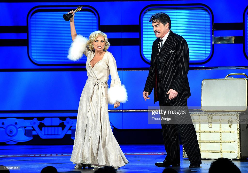 Kristen Chenoweth Peter Gallagher and the cast of 'On The Twentieth Century' perform onstage at the 2015 Tony Awards at Radio City Music Hall on June...