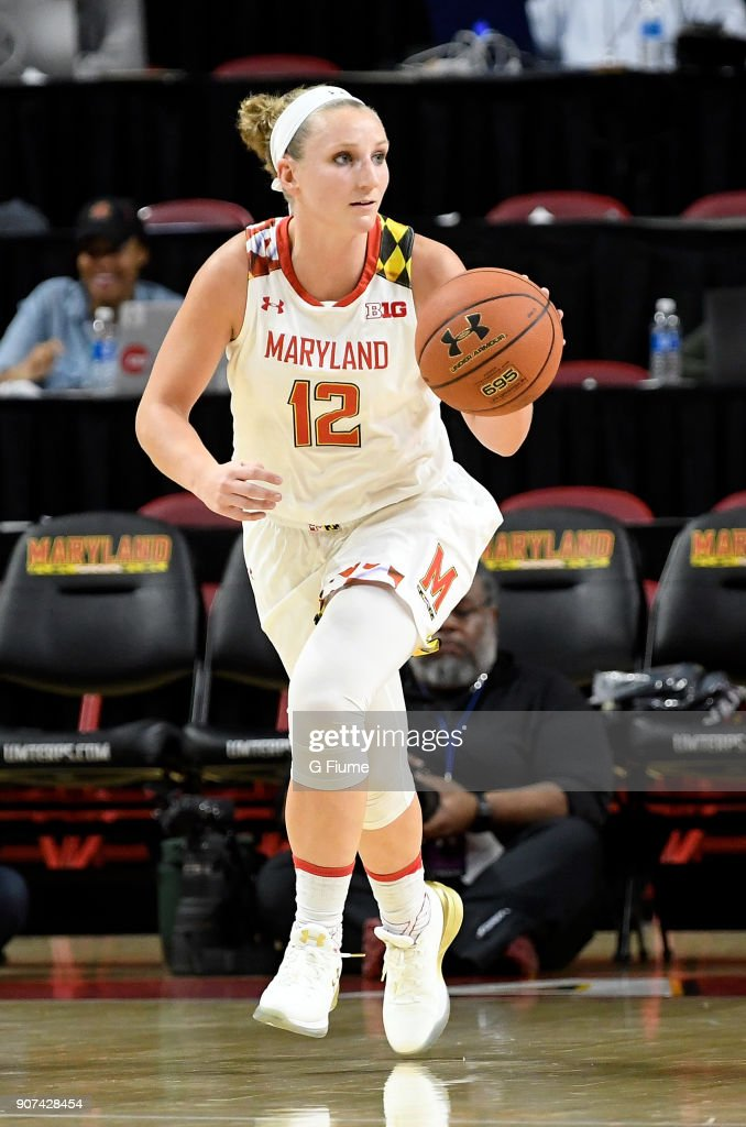 Kristen Confroy #12 of the Maryland Terrapins handles the ball against the Mount St. Mary's Mountaineers at Xfinity Center on December 6, 2017 in College Park, Maryland.