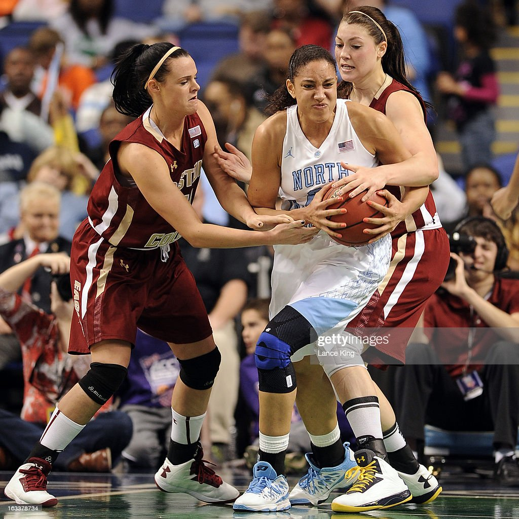 Kristen Doherty #21 and Katie Zenevitch #45 of the Boston College Eagles pressure Krista Gross #21 of the North Carolina Tar Heels during the quarterfinals of the 2013 Women's ACC Tournament at the Greensboro Coliseum on March 8, 2013 in Greensboro, North Carolina.