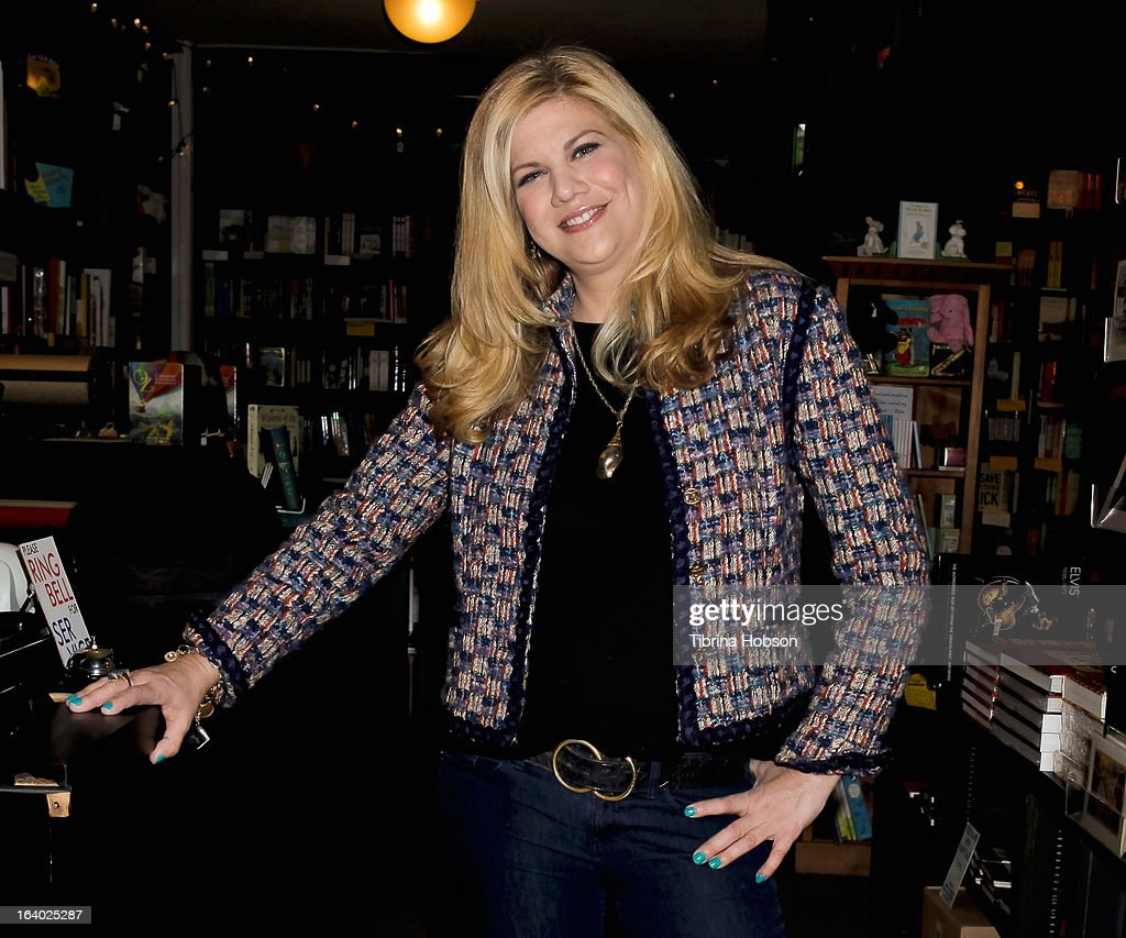<a gi-track='captionPersonalityLinkClicked' href=/galleries/search?phrase=Kristen+Johnston&family=editorial&specificpeople=680408 ng-click='$event.stopPropagation()'>Kristen Johnston</a> signs copies of her book 'Guts' at Book Soup on March 18, 2013 in West Hollywood, California.