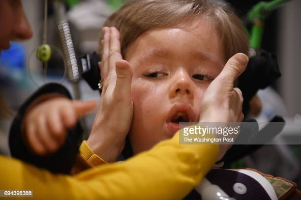 Kristen Lasko covers the ears of her son Max age 35 while speaking about his illness and life expectancy to the reporter of The Washington Post via...