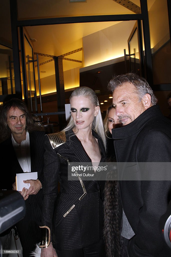 Kristen McMenamy and Kevin Costner attend the Versace Spring/Summer 2013 Haute-Couture show as part of Paris Fashion Week at Le Centorial on January 20, 2013 in Paris, France.