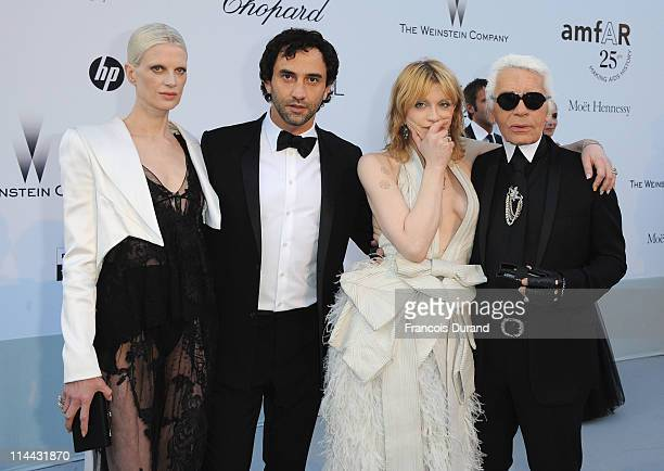 Kristen McMenamy Riccardo Tisci Courtney Love and Karl Lagerfeld attends amfAR's Cinema Against AIDS Gala during the 64th Annual Cannes Film Festival...