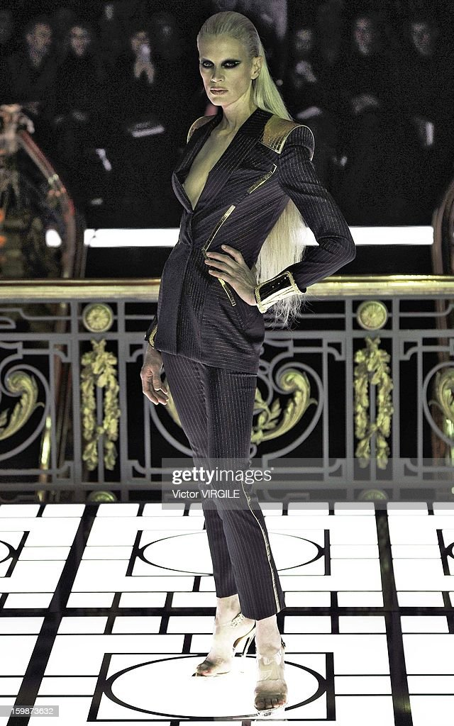 Kristen McMenamy walks the runway during the Atelier Versace Spring/Summer 2013 Haute-Couture show as part of Paris Fashion Week at Le Centorial on January 20, 2013 in Paris, France.