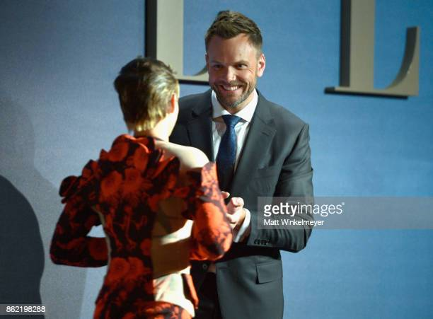 Kristen Stewart and Joel McHale speak onstage at ELLE's 24th Annual Women in Hollywood Celebration presented by L'Oreal Paris Real Is Rare Real Is A...