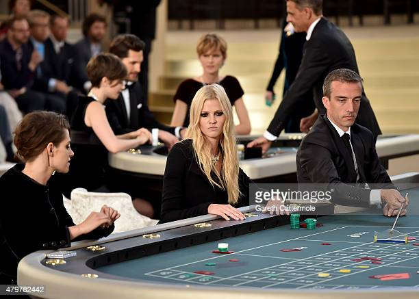 Kristen Stewart and Lara Stone attend the Chanel show as part of Paris Fashion Week Haute Couture Fall/Winter 2015/2016 at the Grand Palais on July 7...