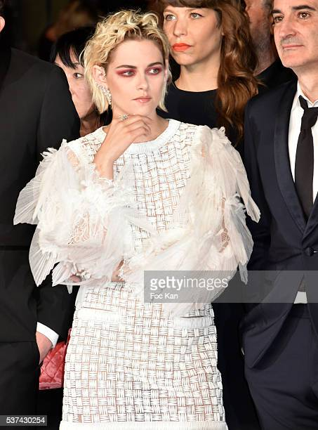 Kristen Stewart and Olivier Assayas attend the 'Personal Shopper' premiere during the 69th annual Cannes Film Festival at the Palais des Festivals on...