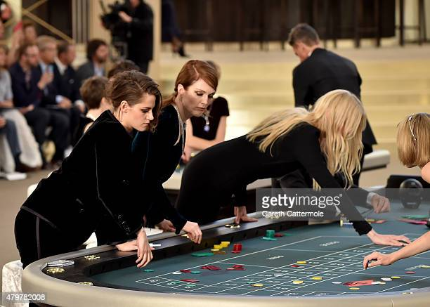 Kristen Stewart Julianne Moore and Lara Stone attend the Chanel show as part of Paris Fashion Week Haute Couture Fall/Winter 2015/2016 at the Grand...