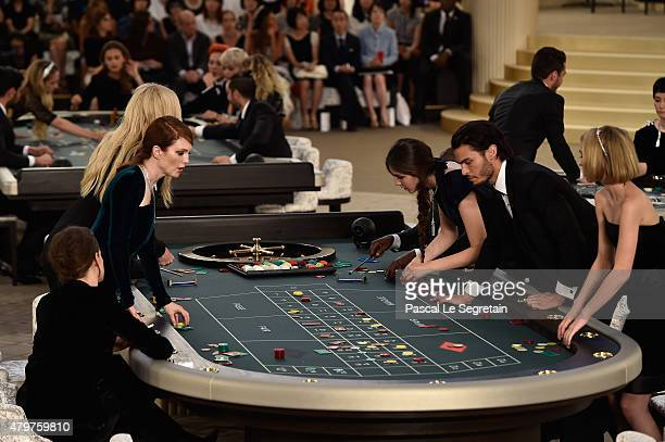 Kristen Stewart Julianne Moore Lara Stone Tugba Sungoruglu Baptiste Giabiconni and Lily Rose Depp attend the Chanel show as part of Paris Fashion...