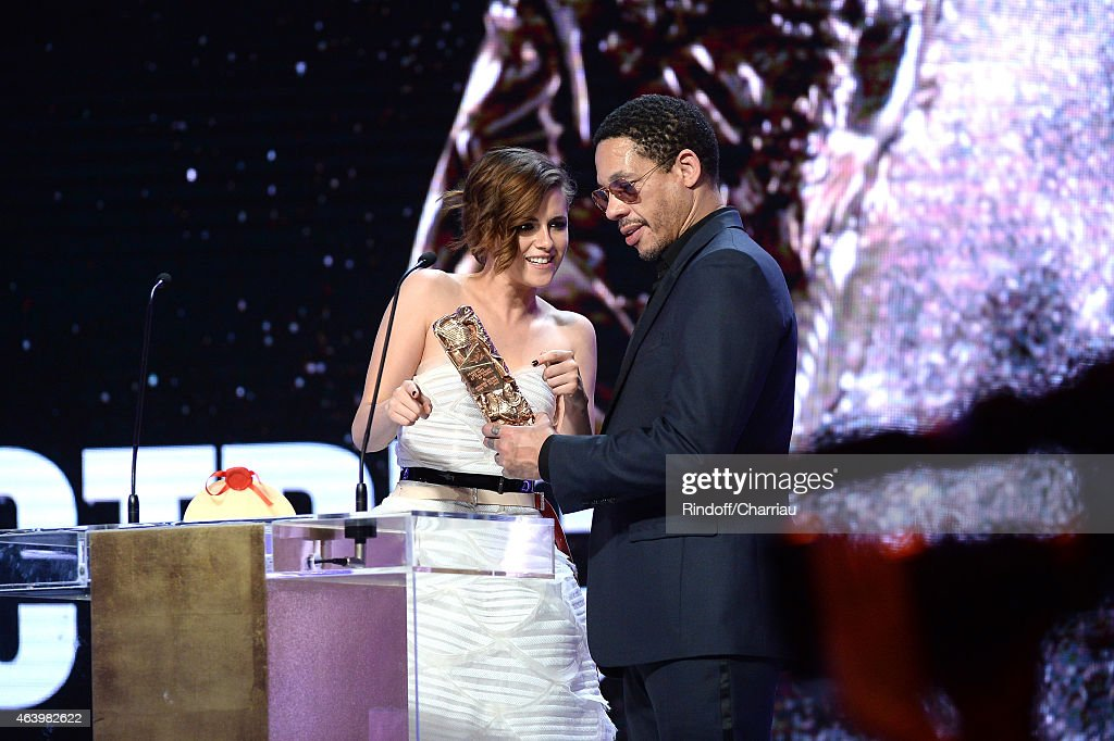 Kristen Stewart receives from JoeyStarr the award for Best Actress in a Supporting Role in 'Sils Maria' during the 40th Cesar Film Awards 2015 Ceremony at Theatre du Chatelet on February 20, 2015 in Paris, France.
