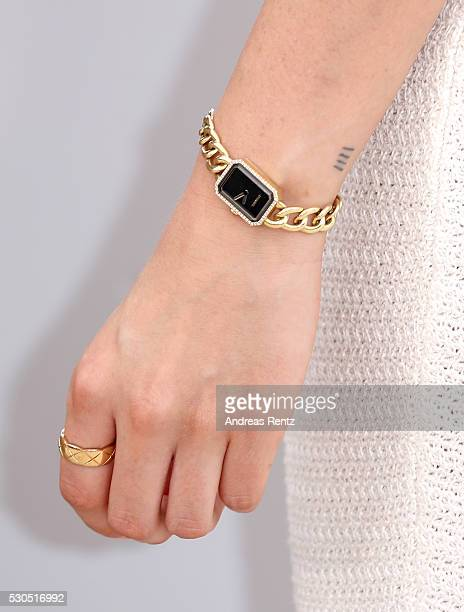 Kristen Stewart ring and watch detail attends the 'Cafe Society' Photocall during The 69th Annual Cannes Film Festival on May 11 2016 in Cannes France
